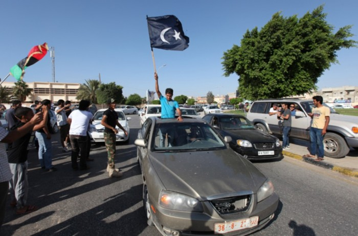 The black Cyrenaica flag is used by federalist protesters who aim to create an eastern region with some level of autonomy from Tripoli [David Poort]